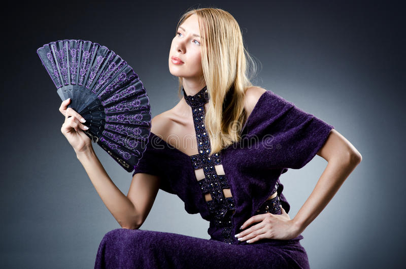 Download Beautiful woman with  fan stock image. Image of female - 26480577