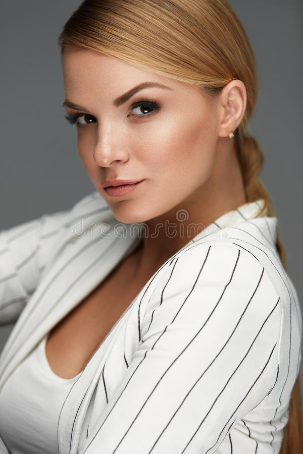 Beautiful Woman In Fashion Clothes With Makeup And Hairstyle. Fashion And Beauty. Beautiful Woman In Fashion Clothes With Face Makeup And Blonde Hair Style. High stock photo
