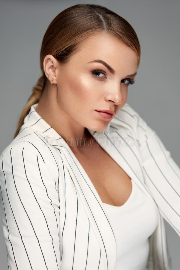 Beautiful Woman In Fashion Clothes With Makeup And Hairstyle. Fashion And Beauty. Beautiful Woman In Fashion Clothes With Face Makeup And Blonde Hair Style. High royalty free stock images