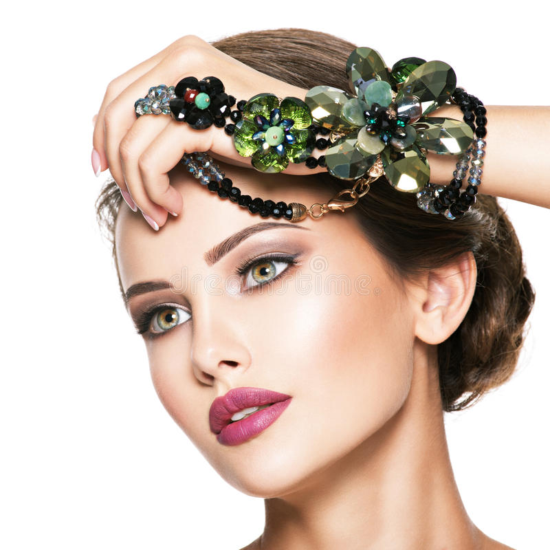 Beautiful woman with fashionable green jewelry stock photography