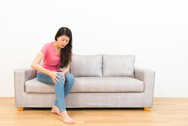Beautiful woman feeling knee pain after the sport royalty free stock image