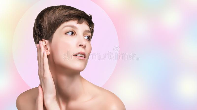 Beautiful female face close up. portrait of young model at studio on white. Beautiful woman. Female face and hands close up. Portrait of young caucasian woman at stock image
