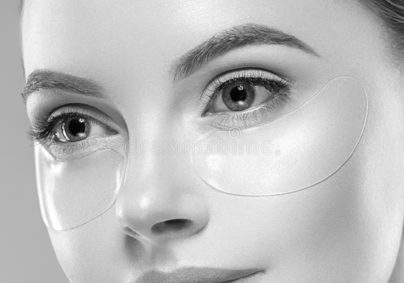 Beautiful woman female skin care healthy hair and skin close up face beauty portrait. Studio shot royalty free stock image