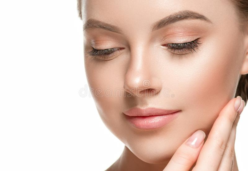 Beautiful woman female skin care healthy hair and skin close up face beauty portrait. Studio shot royalty free stock photo