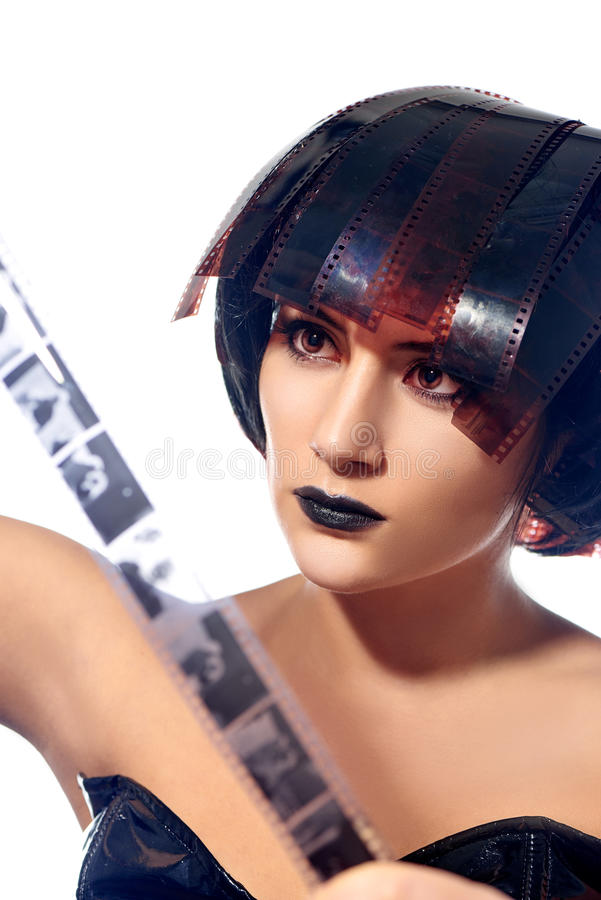 Beautiful woman with filmstrips hairstyle royalty free stock image