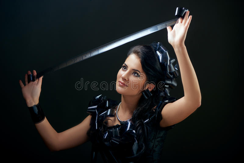 Beautiful woman with filmstrips hairstyle royalty free stock photography