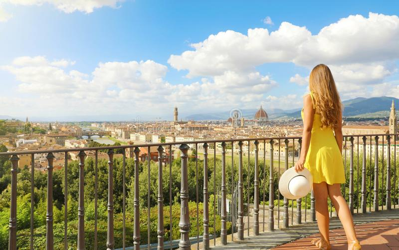 Beautiful woman in Florence birthplace of the Renaissance. Full length view of pretty girl enjoying panoramic view of Florence stock images