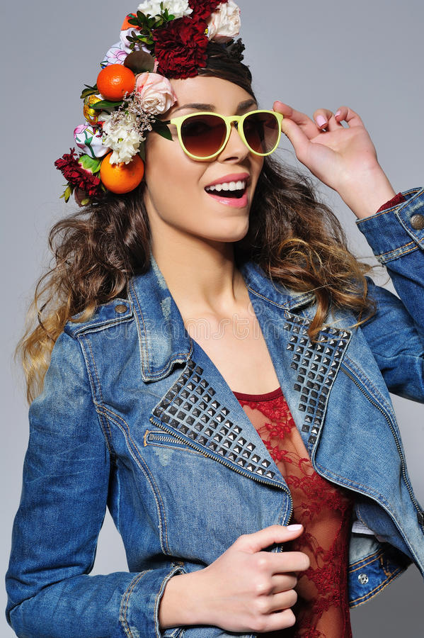 Beautiful woman in flower crown wearing sunglasses stock photography