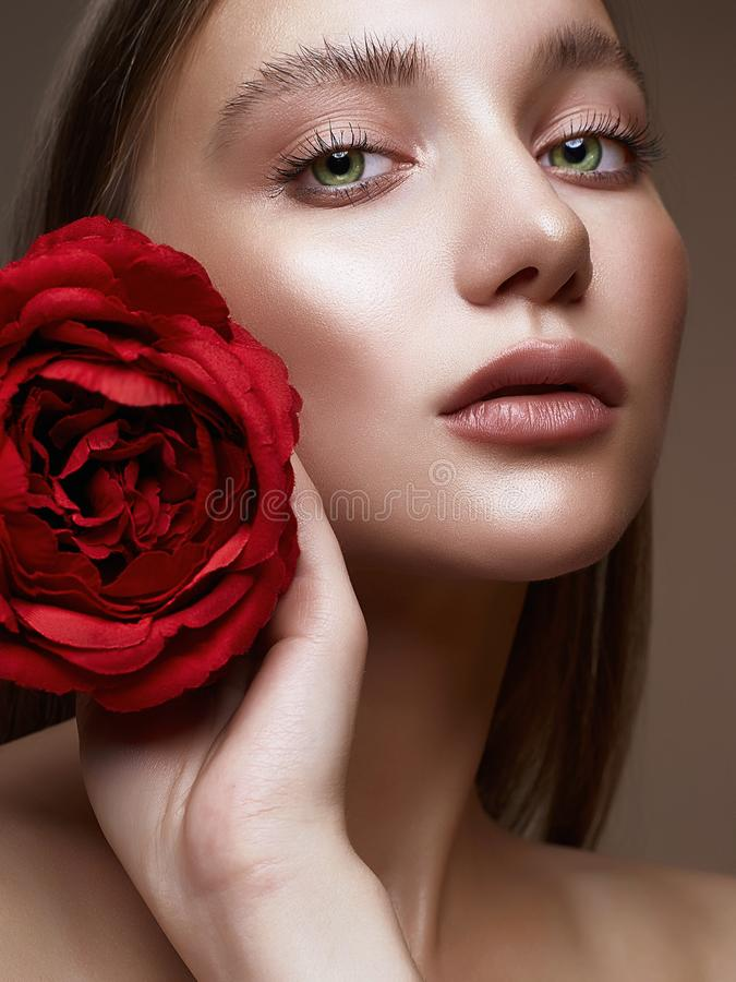 Beautiful Woman with Flower. girl with make-up and Rose. Beautiful young Woman with Flower. Lovely girl with beauty make-up and Rose. beauty portrait.wet makeup stock photos