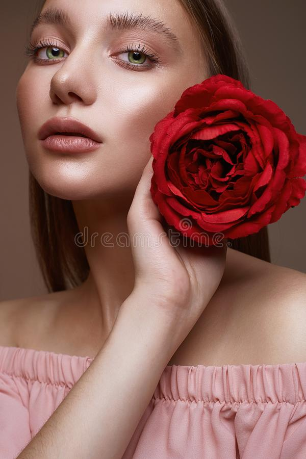 Beautiful Woman with Flower. girl with make-up and Rose. Beautiful young Woman with Flower. Lovely girl with beauty make-up and Rose. beauty portrait.wet makeup royalty free stock images