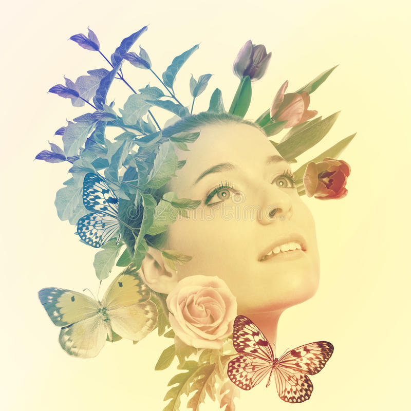 Beautiful woman with flowers and butterflies stock image
