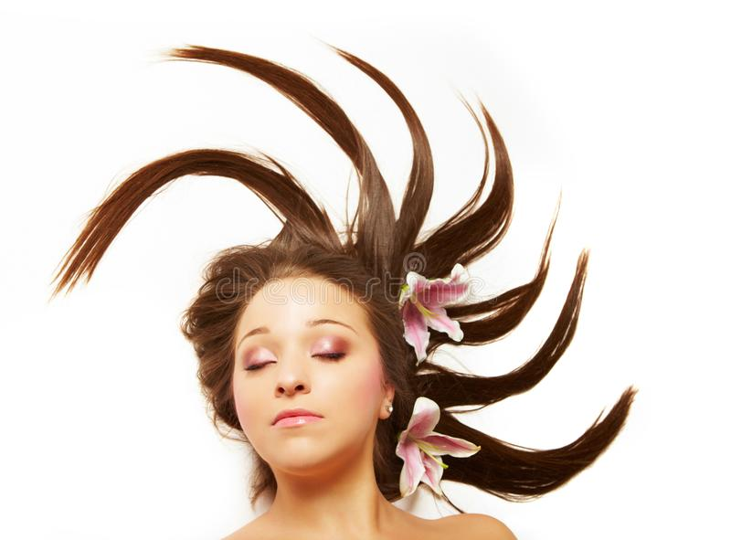 Beautiful woman with flowers in hair stock images