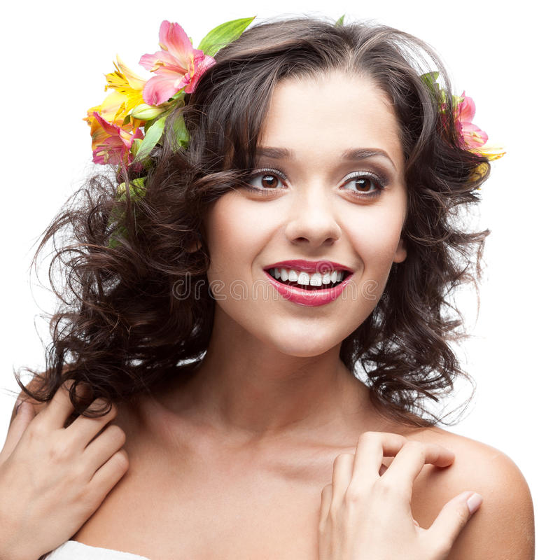 Beautiful woman with flowers in hair. Smiling isolated on white royalty free stock photo