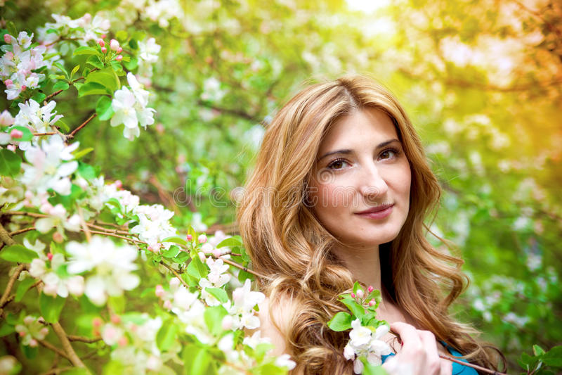 Beautiful woman in flowers stock photo