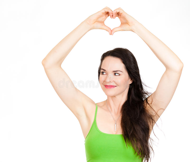 Beautiful woman forming love heart with hands