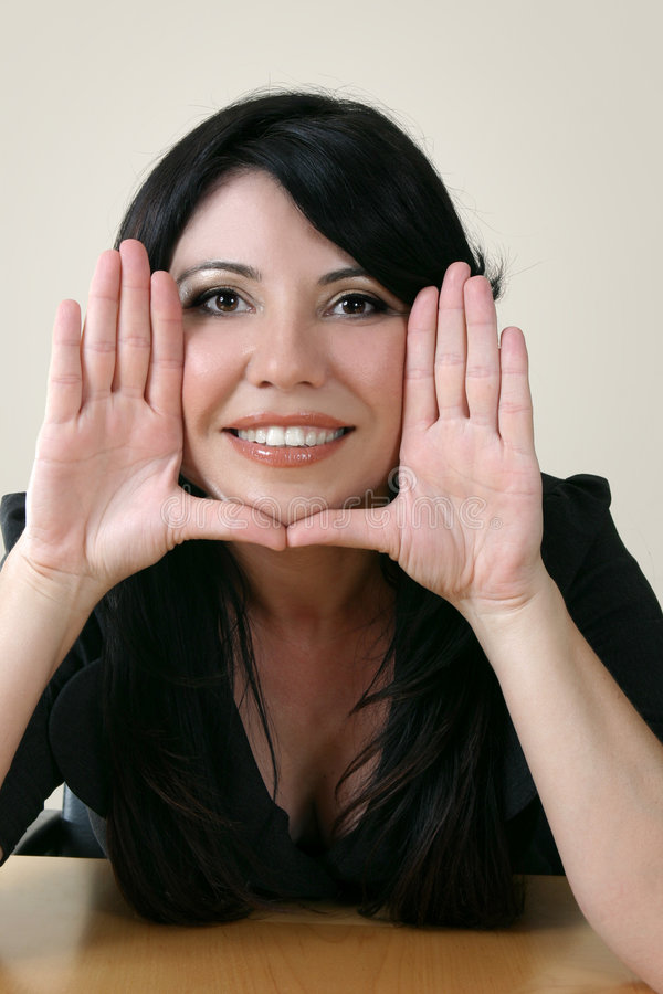 Beautiful woman framing face stock photography