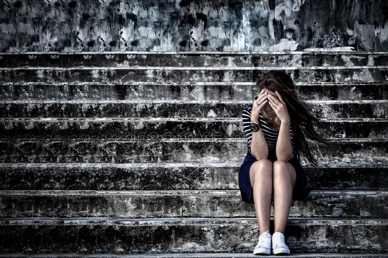 Beautiful woman in frustrated depression sitting on the stairs, stock images
