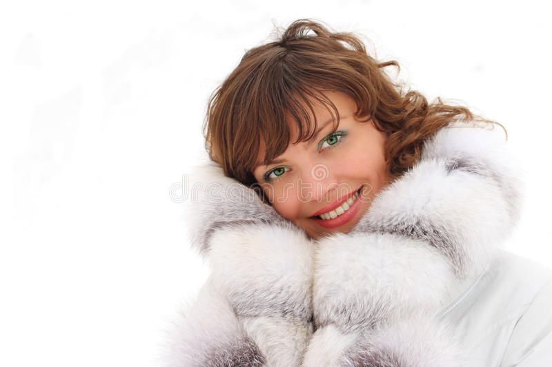 Beautiful woman in fur coat royalty free stock images