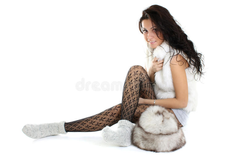 Beautiful Woman With Fur Hat  Sitting Stock Images