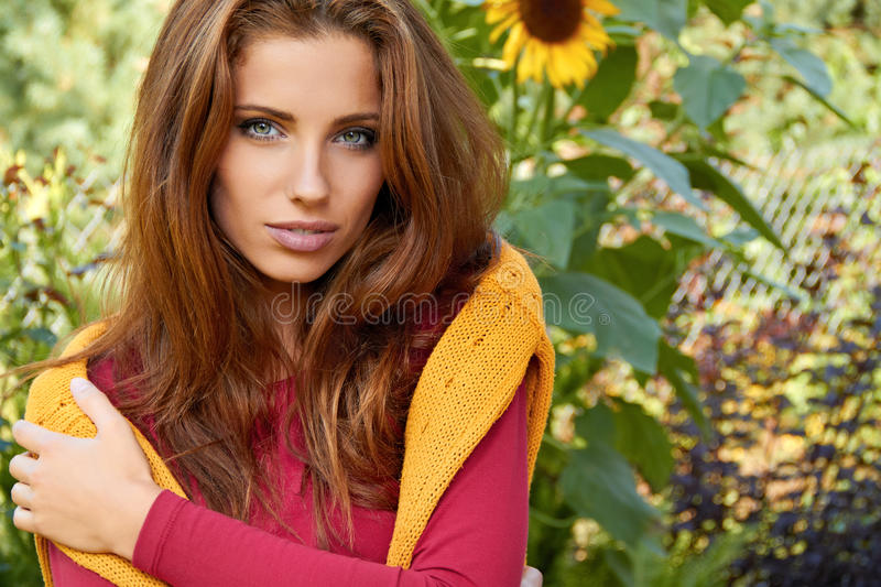 Beautiful woman in garden royalty free stock photo