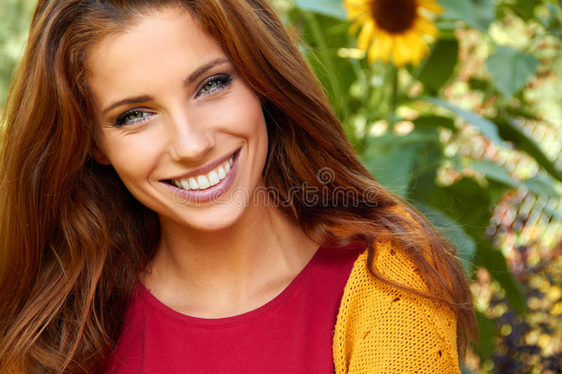 Beautiful woman in garden royalty free stock photos