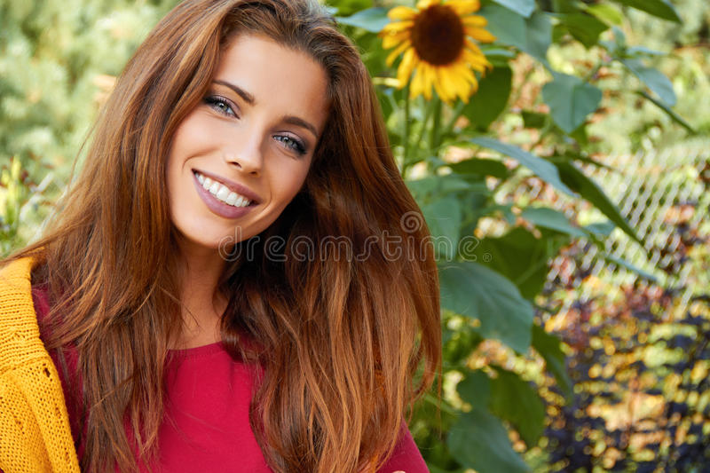 Beautiful woman in garden royalty free stock image
