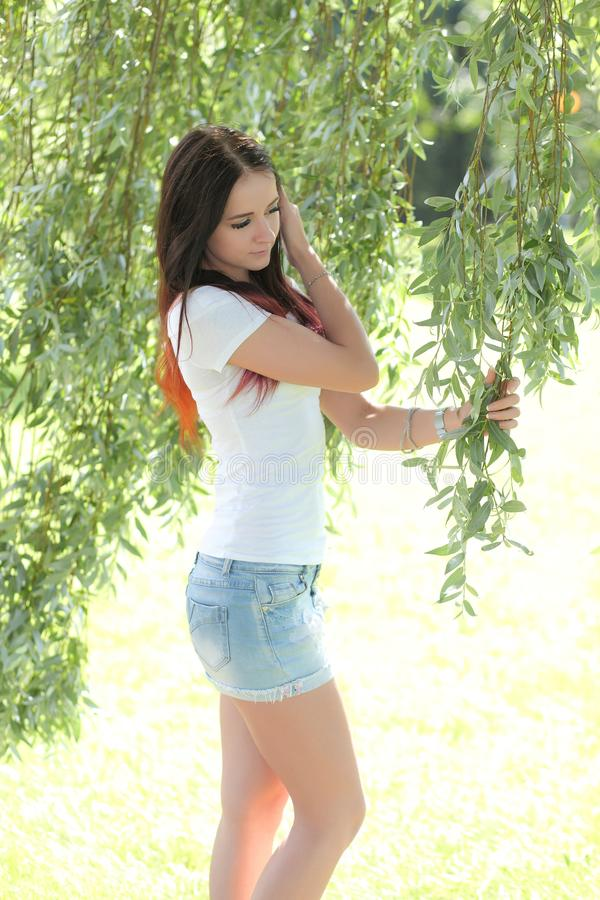 Beautiful woman in the garden stock photos