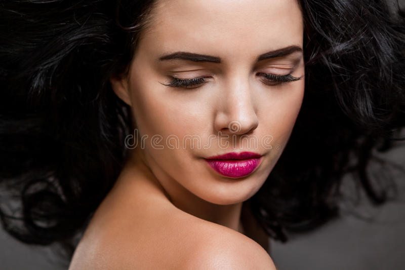 Beautiful woman with a gentle serene expression stock photos