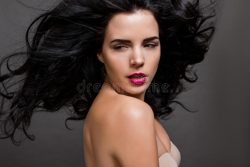 Beautiful woman with a gentle serene expression stock photography