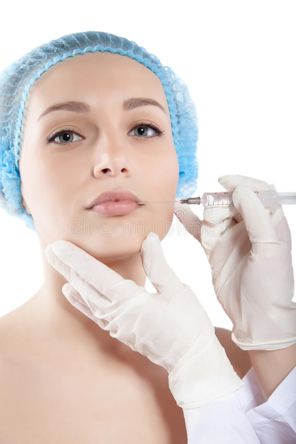 Free Beautiful Woman Gets An Injection In Her Face Royalty Free Stock Photography - 51821947