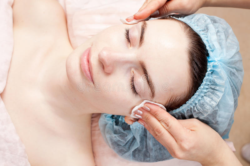 Beautiful woman getting beauty facial treatment stock images
