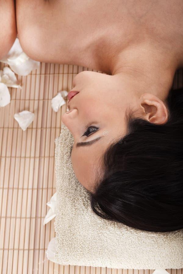Beautiful woman getting spa treatment stock image