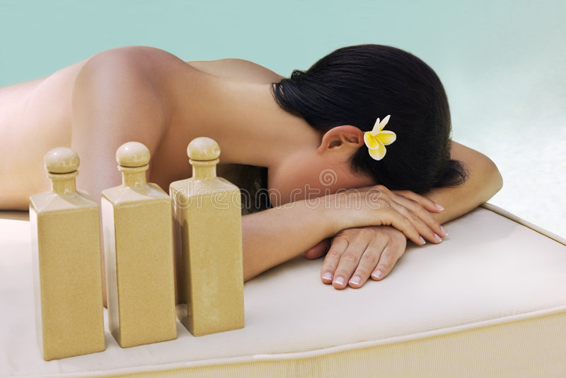 Beautiful woman getting spa treatment stock photography