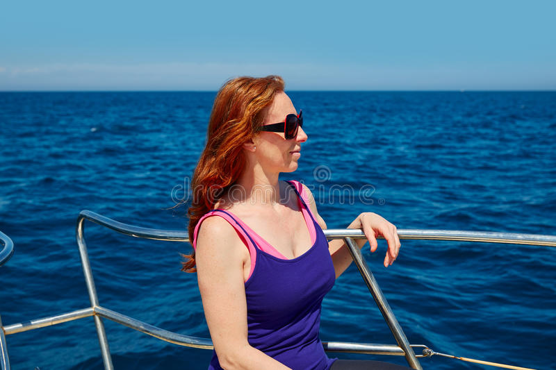 Beautiful woman girl in a boat relaxed profile royalty free stock images