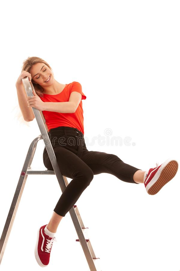 Beautiful Woman, Girl Wearing red t shirt Portrait Of Female With Beauty Face Posing Near metal Ladder In Studio isolated stock photography