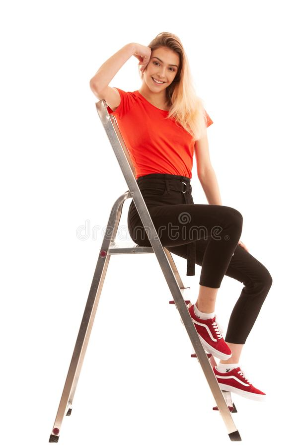 Beautiful Woman, Girl Wearing red t shirt Portrait Of Female With Beauty Face Posing Near metal Ladder In Studio isolated stock image