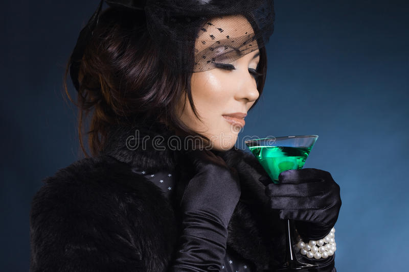 Beautiful woman with glass royalty free stock photo