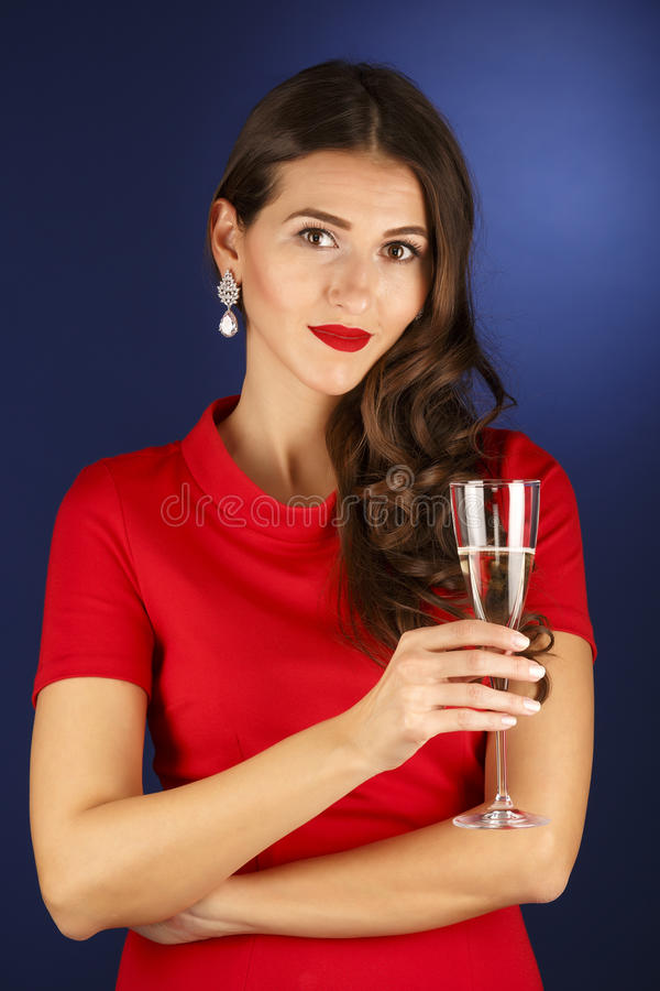 Beautiful woman with glass of champagne. Celebrate concept stock photo