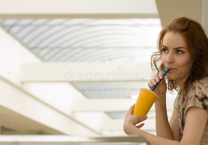 Beautiful woman with a glass of juice stock image