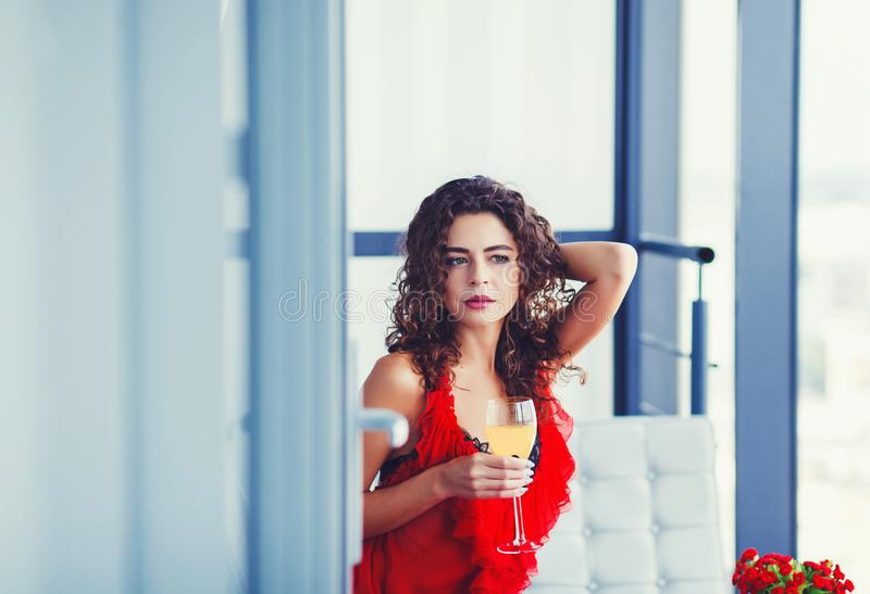 Beautiful woman with glass of wine royalty free stock image