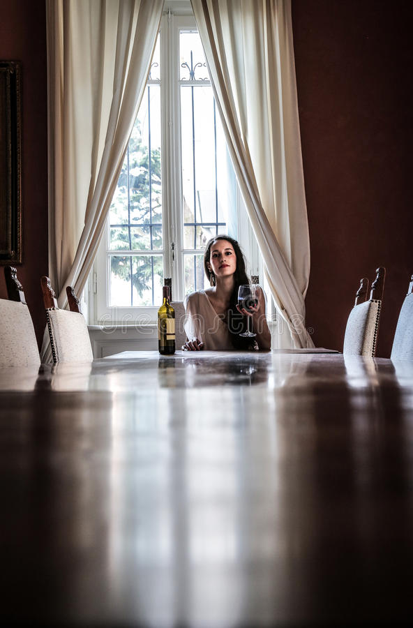 Download Beautiful Woman With A Glass Of Wine Sitting At The Table Stock Photo - Image of attractive, window: 39503648