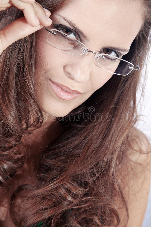 Beautiful woman and glasses stock photos