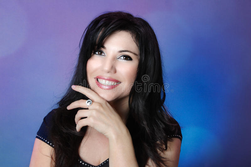 Beautiful woman with glossy black hair and big happy smile royalty free stock photo
