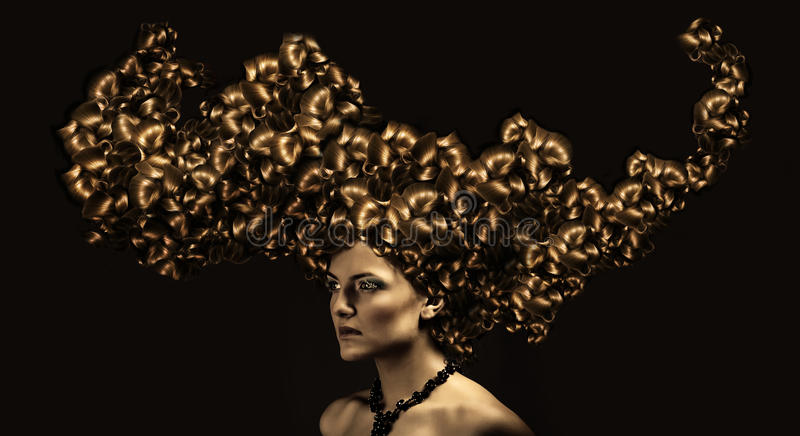 Beautiful woman with gold curly hair stock photo