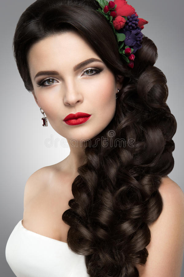 Beautiful woman with gold makeup.Beautiful bride with fashion wedding hairstyle. stock images