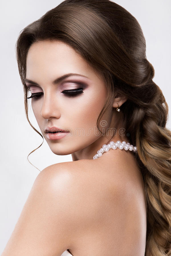 Beautiful woman with gold makeup.Beautiful bride with fashion wedding hairstyle. Beautiful bride with fashion wedding hairstyle. Beauty royalty free stock photo