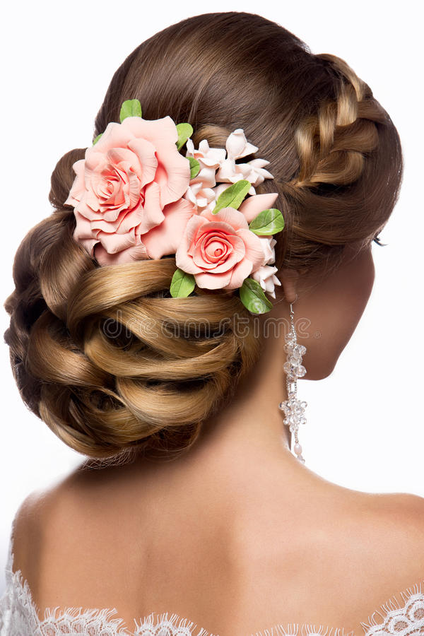 Beautiful woman with gold makeup.Beautiful bride with fashion wedding hairstyle. stock photography