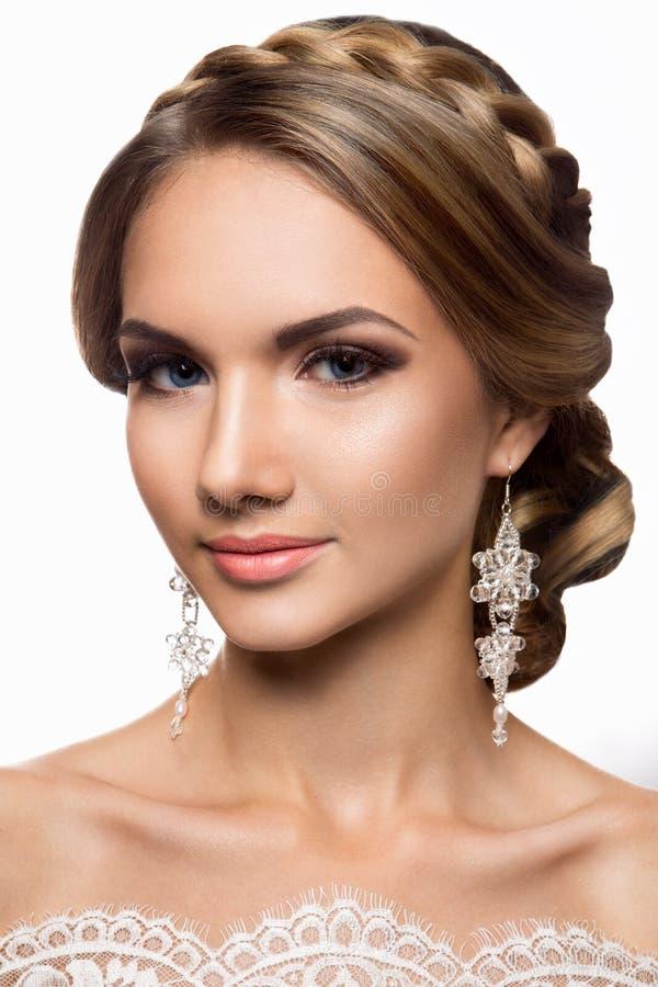 Beautiful woman with gold makeup.Beautiful bride with fashion wedding hairstyle. Beautiful bride with fashion wedding hairstyle. Beauty stock photos