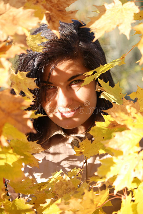 Beautiful Woman With Golden Leafage Royalty Free Stock Photo