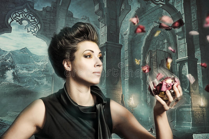 Beautiful woman in a Gothic castle. Beautiful woman in a Gothic ancient castle stock photo
